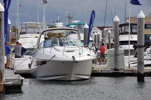 BOAT SHOW: Salesmen and customers look over new boats Friday at the Atlantic City In-Water Power Boat Show at Frank S. Farley Marina. - Michael Ein