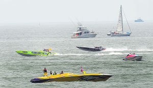 AC Power Boats: The Geico team pace boat leads Tug It 66 on the practice lap. Sunday June 23 2013 Atlantic City Offshore Grand Prix powerboat race off the beach in Atlantic City. (The Press of Atlantic City / Ben Fogletto)  - Ben Fogletto
