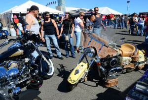 ROAR TO THE SHORE: Attendees check out motorcycles for sale in the parking lot of the Convention Center. Saturday September 7 2013 Tens of thousands of motorcycles gather in Wildwood this weekend for the annual Roar to the Shore. (The Press of Atlantic City / Ben Fogletto) - Ben Fogletto
