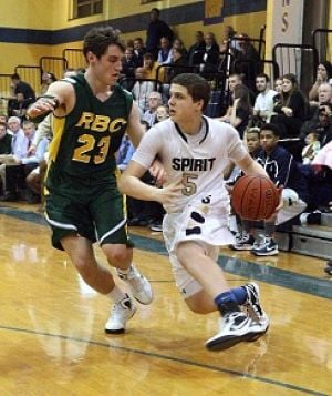 Spirit Photo: Holy Spirit's Matt Sommers, rights drives past Red Bank Catholic's Jesse Flaherty on Tuesday in Absecon.