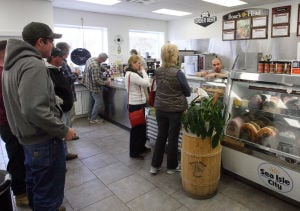 Polar Plunge: Customers wait in line at Mrs. Brizzle's on Landis Avenue in Sea Isle City. Sea Isle City is expected as many as 40,0000 people for a long weekend of food, music and fun.  - Dale Gerhard