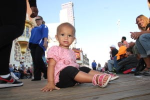 MISS AMERICA PARADE: Kai Thomas 1 year-old of Oceanview show off her shoe during Miss America parade on Atlantic City Boardwalk Saturday, Sept 14, 2013. - Edward Lea