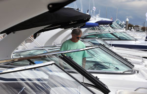 BOAT SHOW: Richa Diamond, of Media, PA, looks over new boats by Chaparral, Friday Sept. 27, 2013, at the Atlantic City In-Water Power Boat Show at Frank S. Farley Marina. (Staff Photo by Michael Ein/The Press of Atlantic City) - Michael Ein