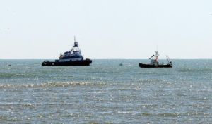 Missing Boat: Boats are seen off Ocean City Saturday, where the missing boat Cape Hatteras was found. Capt. David C. McAuliffe, 34, of Egg Harbor Township remains missing and is presumed dead.  - Photo by Edward Lea
