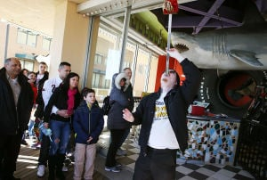 SWORD SWALLOWERS: David Peyre-Ferry, of Oxford, Pa., prepares to swallow a sword Saturday at Ripley's Believe It or Not Museum in Atlantic City. - Ben Fogletto