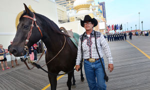 AC Salutes Armed Forces Parade: Guy Collins of Buena leads 'Blackie', representing the riderless horse. Monday June 24 2013 Atlantic City Salutes America's Armed Forces Parade Atlantic City Boardwalk. (The Press of Atlantic City / Ben Fogletto)  - Ben Fogletto