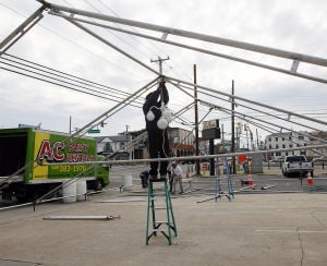 Polar Plunge: Henry Rodriguez of AC Party Rentals in Egg Harbor Township begins to put up a tent in the parking lot of La Costa on Landis and JFK in Sea Isle in preparation for this weekend's event.  - Photo by Dale Gerhard