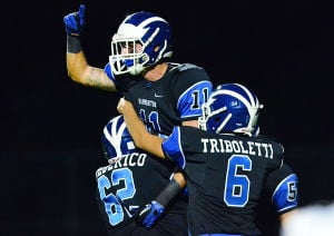 Hammonton Football: Hammonton 11 Dylan Mento celebrates with teammates 62 Robert Frederico and 6 Jonathan Triboletti after a TD catch during the first half. Friday September 27 2013 EHT at Hammonton Football. (The Press of Atlantic City / Ben Fogletto) - Ben Fogletto