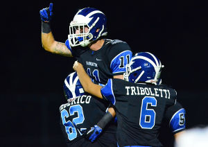 Hammonton Football: Hammonton 11 Dylan Mento celebrates with teammates 62 Robert Frederico and 6 Jonathan Triboletti after a TD catch during the first half. Friday September 27 2013 EHT at Hammonton Football. (The Press of Atlantic City / Ben Fogletto) - Photo by Ben Fogletto