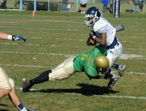 Holy Spirit Photo: Holy Spirit's Angelo Dawson tackles Atlantic City's Demond Cottman during the team's annual Thanksgiving Day game. Dawson  returned an interception 60 yards for a touchdown last weekend.  - Photo by Danny Drake