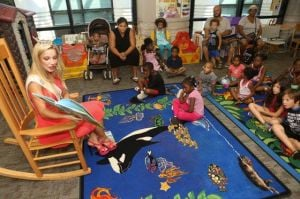Children At Atlantic City Library Get Visit From Miss New Jersey, Who Reads To Them: Miss New Jersey Cara McCollum read the book 'How Rocket Learned to Read' to children Aug. 27 at the Atlantic City Free Public Library.