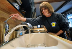 F24 Hammonton Water: Hammonton resident Judy O'Neil has been drinking only bottled water since hearing that her local water supply showed high levels of radium. New equipment to remove contaminants is solving the problem, though.  - Photo by Michael Ein