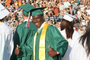 MAINLAND REGIONAL GRADUATION: Graduate Arsene Eliacin, 18 of Somers Point gives thumbs up as he take part in Mainland Regional High School Graduation Thursday, June 20, 2013.  - Photo by Edward Lea