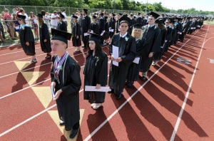 LCMR Graduation: Graduates at Lower Cape May Regional, walk along the track during the commencement ceremony. Lower Cape May Regional High School graduation. Friday June 20, 2014. (Dale Gerhard/Press of Atlantic City) - Dale Gerhard