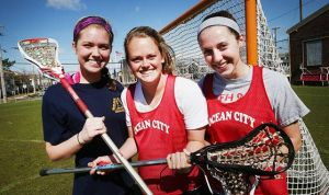 Red Raiders' Bid For Fourth Straight Title Will Be Tough: The Ocean City High School girls lacrosse team, including, from left, Julie Cusack, Abby Lyons and Kelly Hanna, opens its season today against Millville. The Red Raiders won the past three Cape-Atlantic League championships.