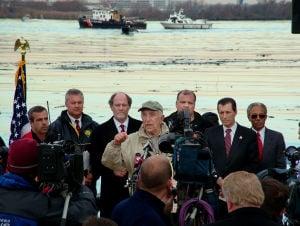 OilSpill10: With Coast Guard and clean up crewsand Phila Airport in BackgroungU.S. Senator Lautenberg(speaking ),Jon Corzine backcenter,State Senator Stephen Sweeney (center back right) and State Sen.John Burzichelli(next to Frank Lautenberg (right)along the Delaware river at oil soaked waterline in Paulsboro across from the Philadelphia Airport .TueNov30/04  - Dominick J. Rebeck Jr.