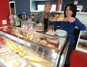 Polar Plunge: Gina Bennett of Rio Grande, left, and Ellen Collins, of Sea Isle, put out bread and pastries at the Red White and Brew Coffee Shop on Landis Avenue.  - Dale Gerhard