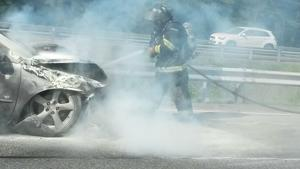 Firefighters douse car with water after Expressway crash