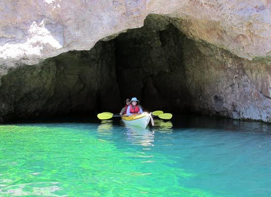 Kayaking through a canyon as part of a Vegas vacation