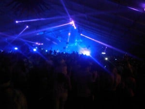 Bader Field Rave: Lasers dance across the audience at the New Year's Eve rave party at Bader Field.  - JOEL LANDAU
