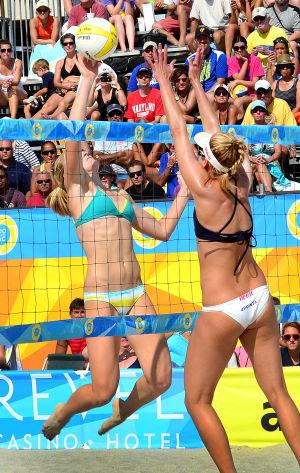 AVP VOLLEYBALL FINALS: Emily Day (left) gets a shoots to the block of April Ross during the women's final. Sunday September 8 2013 AVP beach volleyball tournament in Atlantic City. (The Press of Atlantic City / Ben Fogletto) - Ben Fogletto