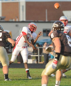Absegami Football: St. Joe's Salaam Horne fires the ball down field during their opening game of the season against Absegami held at Absegami High School in Galloway. Photo/Dave Griffin - David Griffin