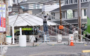 Polar Plunge: Workers begin to put up a tent in the parking lot of La Costa on Landis and JFK in Sea Isle. Sea Isle City's business community briefly emerges from its winter hibernation for the annual polar plunge, which draws as many as 40,000.  - Dale Gerhard