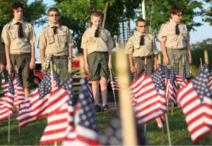 Absecon's Tribute To The Fallen Heroes Of 9/11/2001: From left, Boy Scout Troop 26 members Zonah Zimmerman, 16, of Galloway Township, Zachary Styles, 14, of Galloway, Jonathan Conner, 13, of Galloway, Chris Haines, 12, of Galloway, and Eric Smith, 13 of Northfield, took part in the city of Absecon's Tribute to the Fallen Heroes of 9/11/2001 at Public Safety Park in Absecon. - Sean M. Fitzgerald