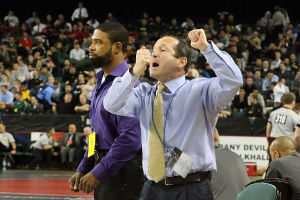 State Wrestling Tournament: Holy Spirit coaches shout instruction during 113 lb - Patrick D'Arcy of Holy Spirit , Lou Raimo of Hanover Park match. Saturday March 8 2014 State Wrestling Championships at Boardwalk Hall Atlantic City. (The Press of Atlantic City / Ben Fogletto) - Ben Fogletto