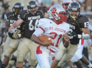 Absegami Football: St. Joe's Cody Sampson looks for running room as Absegami's Abdullah Anderson head in for the tackle during their opening game of the season against Absegami held at Absegami High School in Galloway. Photo/Dave Griffin - David Griffin