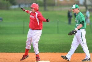 Mainland Baseball: Ocean City designated hitter Mike Inacio, left, reacts after doubling in the third inning Monday at Mainland Regional.  - Ben Fogletto