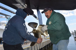 Boating Rebound: Lauro Fernandez (left) and Tony Christopher, both of Somers Point, work on a propeller shaft while preparing a boat for the water at C-Jam Yachts in Somers Point. Tuesday April 2 2013 (The Press of Atlantic City / Ben Fogletto)  - Ben Fogletto