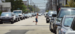 Shore Parking Spaces: A pedestrian crosses between tightly parked cars on Pacific Avenue in Margate. Sunday June 9 2013 (The Press of Atlantic City / Ben Fogletto)  - Ben Fogletto