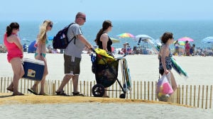 JL08 Holiday Weekend: People walk to the beach near 10th Street in Ocean City. Sunday July 7 2013 4th of July Weekend in Ocean City. (The Press of Atlantic City / Ben Fogletto) - Ben Fogletto
