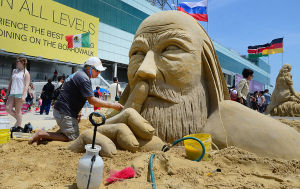 SAND SCULPTING: Sculptor Matt Long of Staten Island New York, an original cast member of the Travel Channel TV show, 'Sand Masters,' works on his entry. Sunday June 16 2013 World Championship of Sand Sculpting on the beach next to the Pier at Caesars in Atlantic City. (The Press of Atlantic City / Ben Fogletto)  - Ben Fogletto
