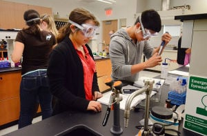 STOCKTON SCIENCE BUILDING: Students Shawna Poltricitsky, 22, of Flemington (left) and Brian Montoya, 22, of Mays Landing, work in a Biochemisty Lab. Tuesday September 17 2013 Unified Science Center at Stockton College. (The Press of Atlantic City / Ben Fogletto) - Ben Fogletto
