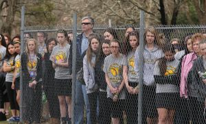 OLMA Softball: Family and friends take part in Our Lady of Marcy ceremony in honoring their former softball coach Jamie Cook who died suddenly over the winter at a young age Tuesday, April 8, 2014. - Edward Lea