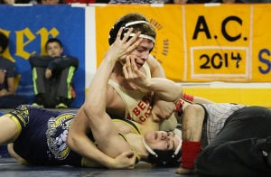 State Wrestling Tournament: Patrick D'Arcy of Holy Spirit (bottom) loses to Nick Suriano of Bergen Catholic in the 113 lb championship. Sunday March 9 2014 State Wrestling Championships at Boardwalk Hall Atlantic City. (The Press of Atlantic City / Ben Fogletto) - Ben Fogletto