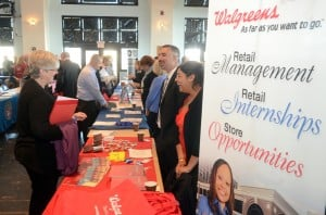 Vet Job Fair: Military spouse, Mary Reimer, of Stow Creek, talks with Walgreen's representatives, John Fredericks, of Berlin, and Kajal Sheth, of the Bargaintown section of Egg Harbor Township. A job fair, at the Ocean City Music Pier, especially geared to military veterans, who experience a much higher unemployment rate than the general working population. It's the latest of several initiatives to help veterans re-enter the workforce. Thursday, October, 11, 2012, 2012 ( Press of Atlantic City/ Danny Drake)