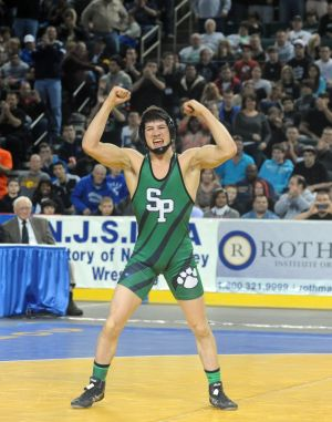 A: South Plainfield's Anthony Ashnault, celebrates his 138-pound victory over Hunterdon Central's Gary Dinmore on Sunday at Boardwalk Hall in Atlantic City.  - Staff Photo By Danny Drake