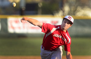 OC Baseball: Ocean City High School starting pitcher Kyle Andrews works his way to a victory over visiting Hammonton on Friday night. The 12-3 Red Raiders, unranked last week, are No. 9 in The Press Elite 11 this week.  - Staff photo by Ben Fogletto