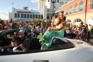 MISS AMERICA PARADE: Miss Arizona Jennifer Smestad show off her shoe as she waves to during Miss America parade on Atlantic City Boardwalk Saturday. - Photo by Edward Lea