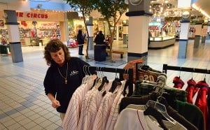 SHORE MALL CLOSINGS: Beachcomber owner Linda Keefe puts on-sale athletic team jerseys out. The store has already made plans to relocate to a smaller shop in Egg Harbor Township.  - Photo by Ben Fogletto