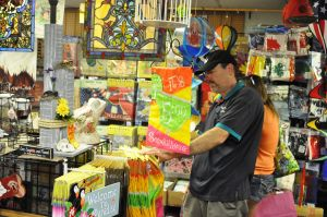 Import Bazaar: Richard Meyers, owner of Import Bazaar, restocks a flag display at his decorations shop on the Washington Street Mall in Cape May.