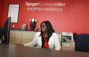Tanger Outlets: Tyesha Ward, 19, of Atlantic City, works at Shopper Services for The Walk.  - Photo by Ed Lea
