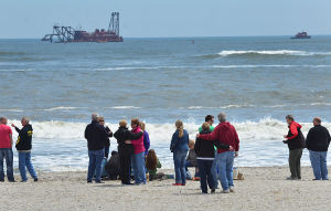 Boat: Family members wait on the beach in Ocean City for the boat to be raised. Sunday April 28 2013 (The Press of Atlantic City / Ben Fogletto)  - Photo by Ben Fogletto