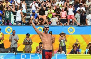 Players Strike Gold In First Visit To A.C.: Jake Gibb celebrates the winning point as fans react at the men's finals of the $100,000 AVP Do AC Pro Beach Volleyball Invitational on Sunday in Atlantic City.