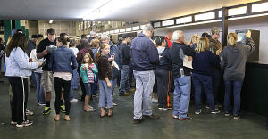 Day At The Races: A line waits to make bets on an automated teller station. Sunday April 27 2014 Live turf racing at the Atlantic City Racecourse in Mays Landing. (The Press of Atlantic City / Ben Fogletto) - Ben Fogletto