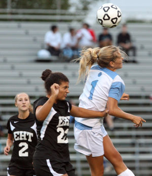 LCM Girls Soccer: Lower's Madie Gibson (1) heads the ball upfield in front of Carley Pappas (22) of Egg Harbor Twp. Lower Cape May Regional vs. Egg Harbor Township girls soccer played in Lower Cape May. Monday Sept. 09, 2013,. (Dale Gerhard Photo/Press of Atlantic City) - Dale Gerhard