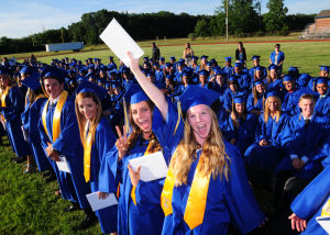 Buena Regional High School Graduation: Graduate Courtney Curcio, 17, from Buena, is all smiles after receiving her diploma during Buena Regional High School's Class of 2014 Commencement Program held at the High School in Buena Friday, June 20, 2014. Photo/Dave Griffin - Dave Griffin